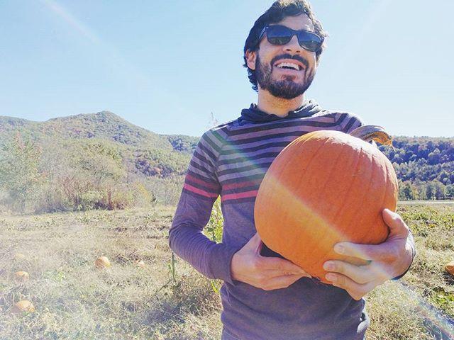 Zach holding a pumpkin
